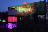 When darkness falls, the containers in the Werksviertel Mittel district are illuminated.