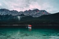 The crystal-clear Eibsee surrounded by rocky landscape can be easily explored by a rowing boat. For those who seek less tiring ways, book a round trip with a motorboat.