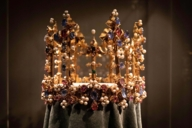 Exhibited in the treasury: a golden crown with countless gemstones and pearls.