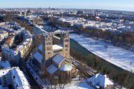 The landmark of Munich's Glockenbachviertel: St. Maximilian's Church towers above the Isar.
