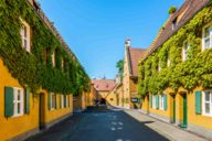 The yellow settlement houses of the Fuggerei in Augsburg.