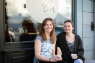 Café owner Stephanie talks to writer Anika over a cup of Flat White in front of her café.