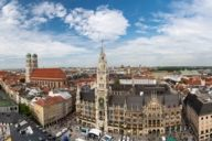 Climb 306 stairs up to the viewing platform of St Peter's Church and enjoy exactly this view of the Marienplatz and the Frauenkirche.