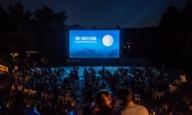 Open Air Cinema in Munich Westpark by night.