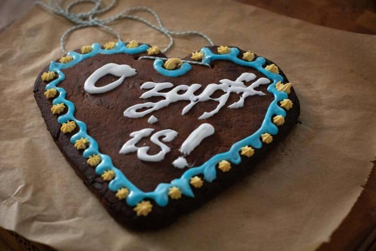 A homemade gingerbread heart with decoration.