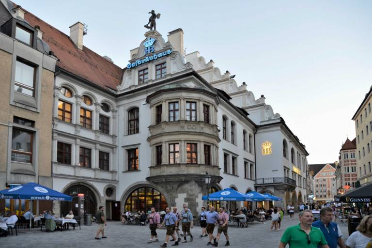 Exterior view of the Hofbräuhaus Munich at dusk.