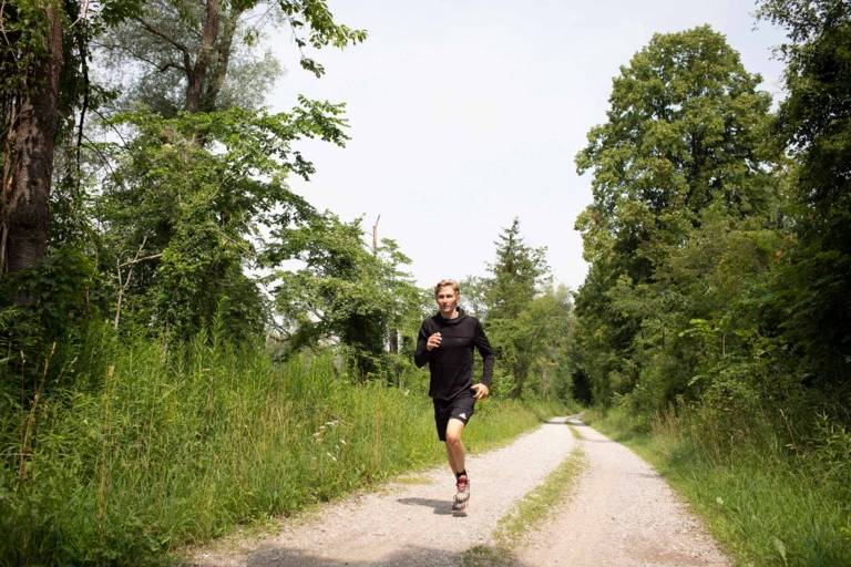 Nico Paufler jogs at the river Isar in Munich.