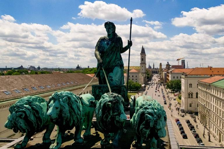 Lion-quadriga on top of the Siegestor in Munich photographed from above with a drone.