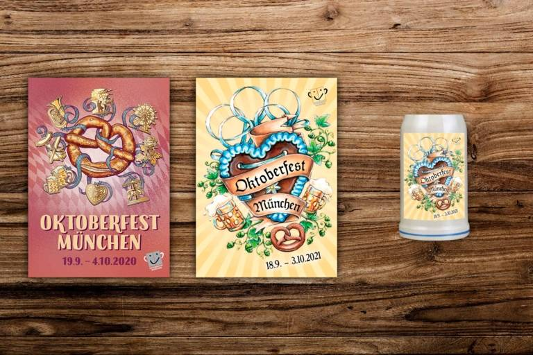 The Oktoberfest posters 2020 and 2021 and the Oktoberfest mug 2021 on a wooden wall