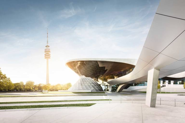 The double helix of BMW Welt in Munich with the Olympic Tower in the background