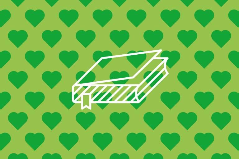 Buch-Icon auf grüner Struktur