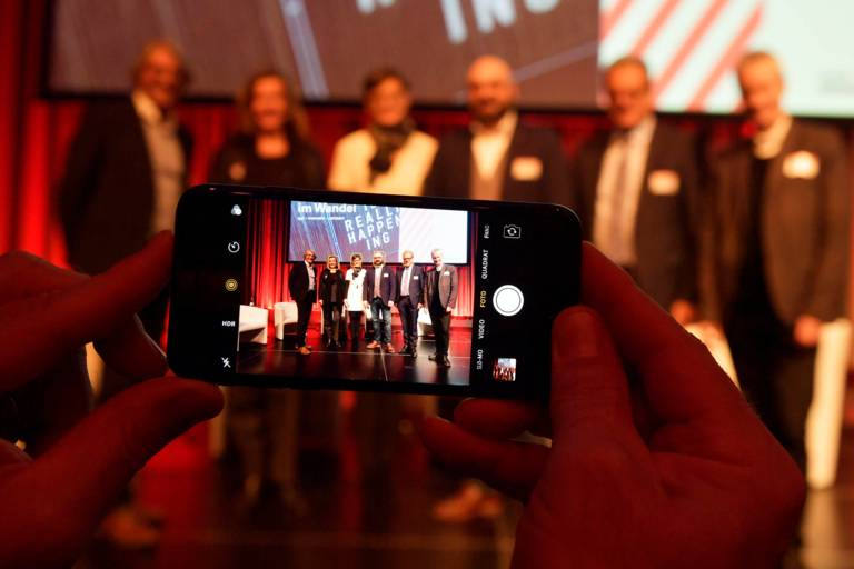 A smartphone taking pictuers at Tourism Day in Munich