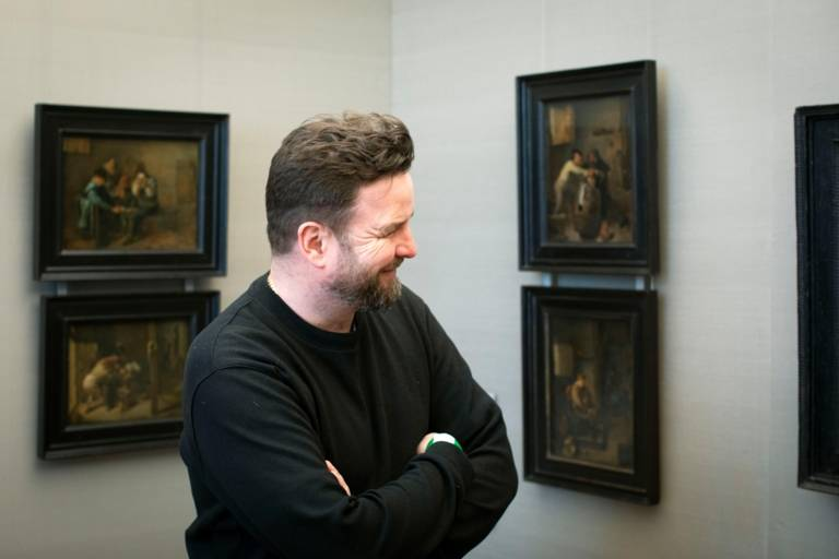 A man looking at paintings in the Alte Pinakothek in Munich