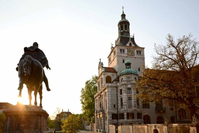 The equestrian statue of Prince Regent Luitpold in front of the Bayerische Nationalmuseum in Munich early in the evening.
