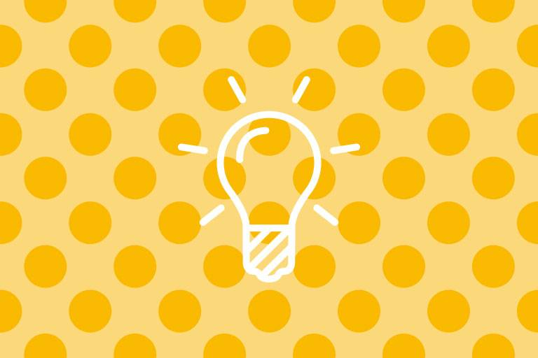 Light bulb icon on yellow structure