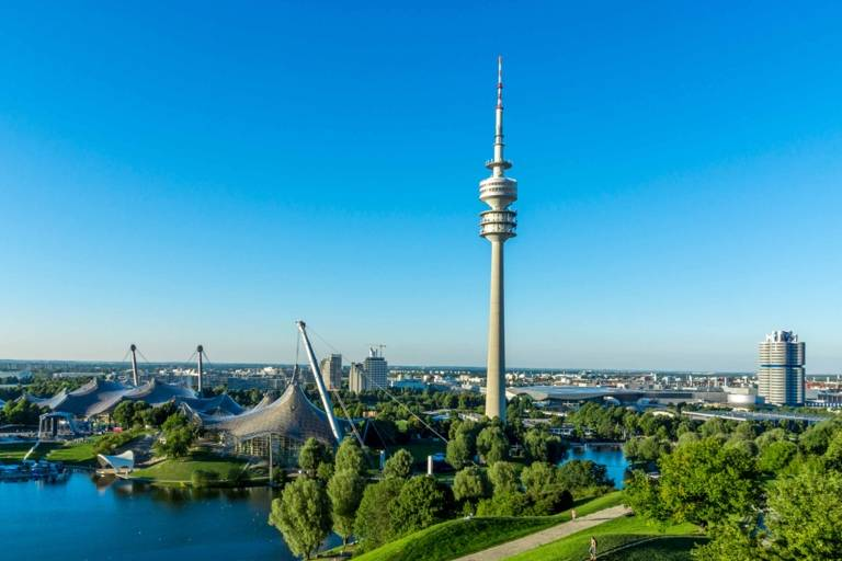 Panoramic view from the Olympiaberg with Olympic Lake, Olympic Tower and the headquarter of BMW in Munich in the background.