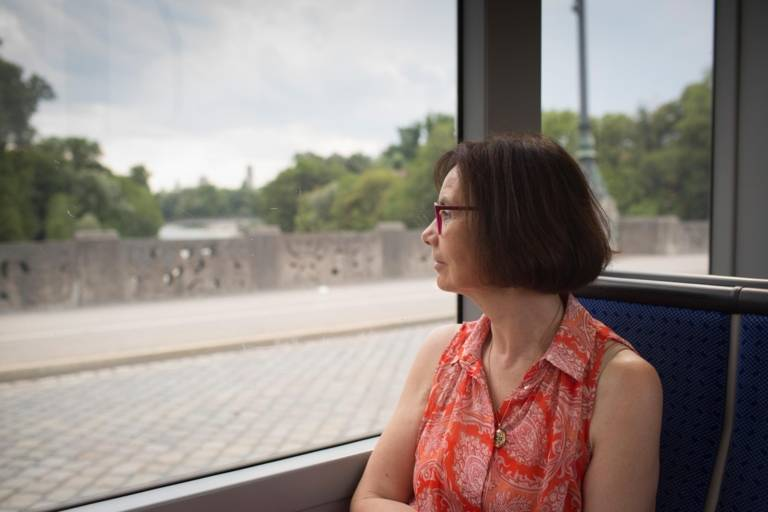 Woman looks out of a tram on the Maximilianstraße in Munich.