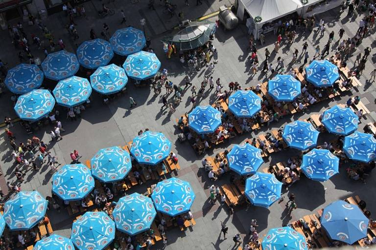 Sun umbrellas of a Restaurant at Marienplatz in Munich photographed from above.