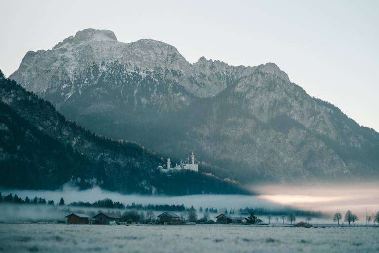 Neuschwanstein Castle in fog in the surrounding region of Munich.