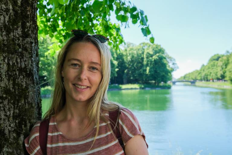 Sarah Althaus stands by a tree on the Nymphenburg Palace canal.