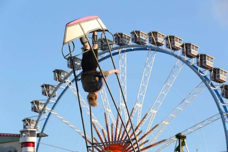 Swingboat and big wheel at the Oktoberfest in Munich.
