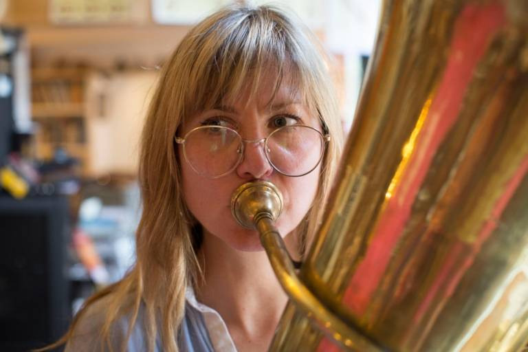 Journalist plays tuba in a music store in Munich.