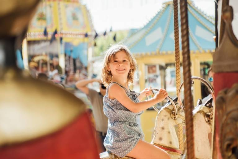 A girl on a carousel at the Auer Dult in Munich.