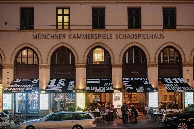 Front view of the Münchner Kammerspiele at Maximilianstraße in Munich at night.