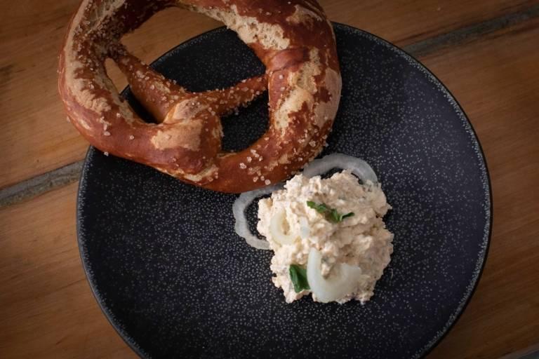 A plate with homemade pretzel and fresh Bavarian cream cheese.
