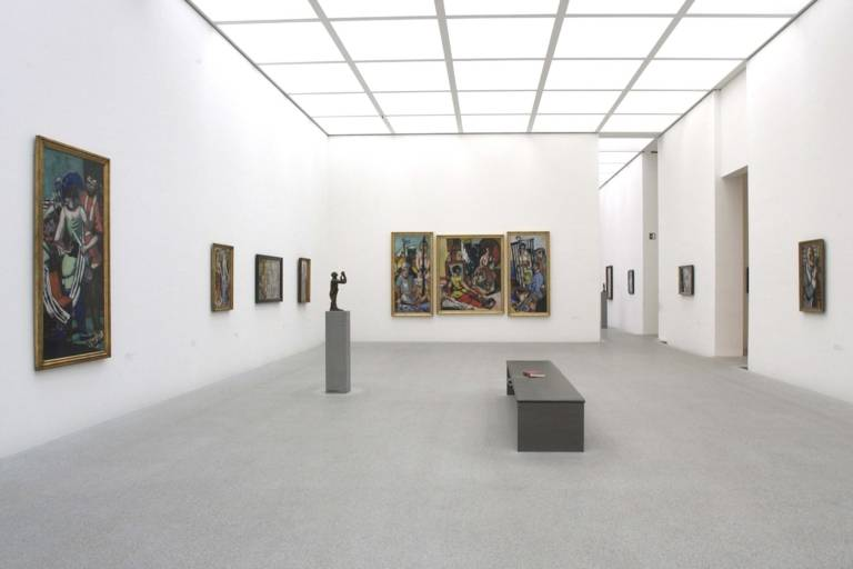 Exhibition room with paintings in the Pinakothek der Moderne in Munich.