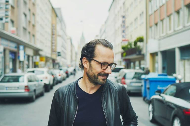 Portrait of the industrial designer Konstantin Grcic on a street in Munich.