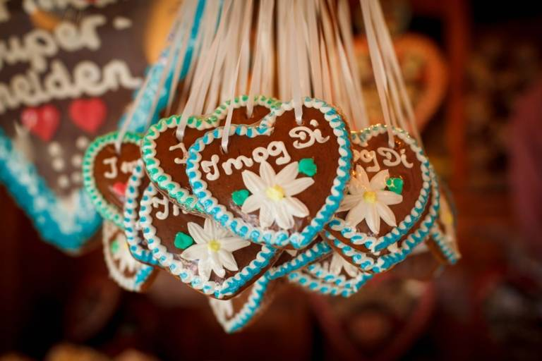 Gingerbread hearts are hanging on a hook of a sales booth at the Oktoberfest in Munich.
