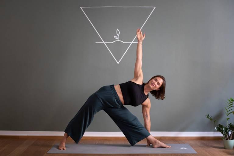 A yoga teacher demonstrates an exercise in Munich.