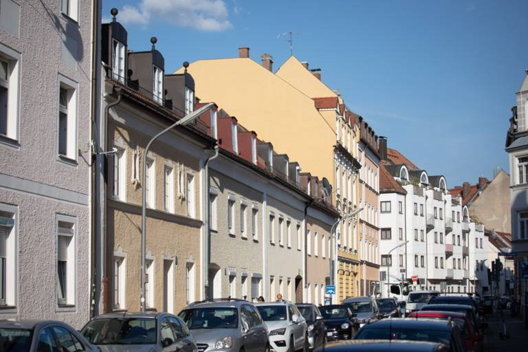 Various house facades in the sunlight in Munich.