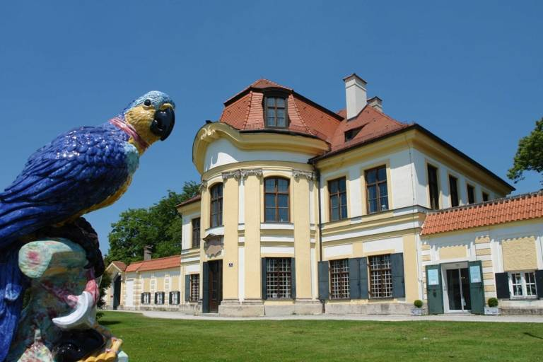 Parrot made out of porcelain in the front garden of the Nymphenburg Porcelain Manufactory in Munich.