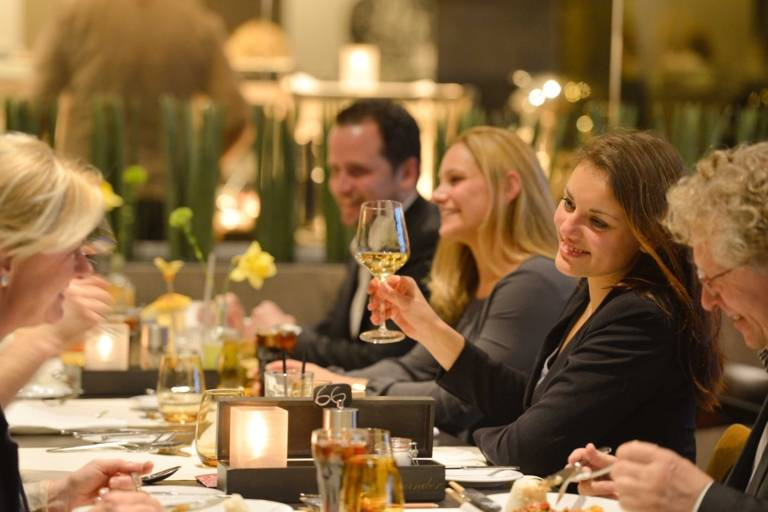 Visitors of the GOP Varieté Theater in Munich enjoy the menu before the show.