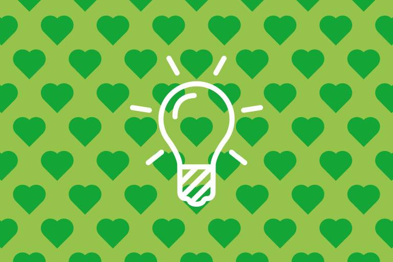 Light bulb on green structure
