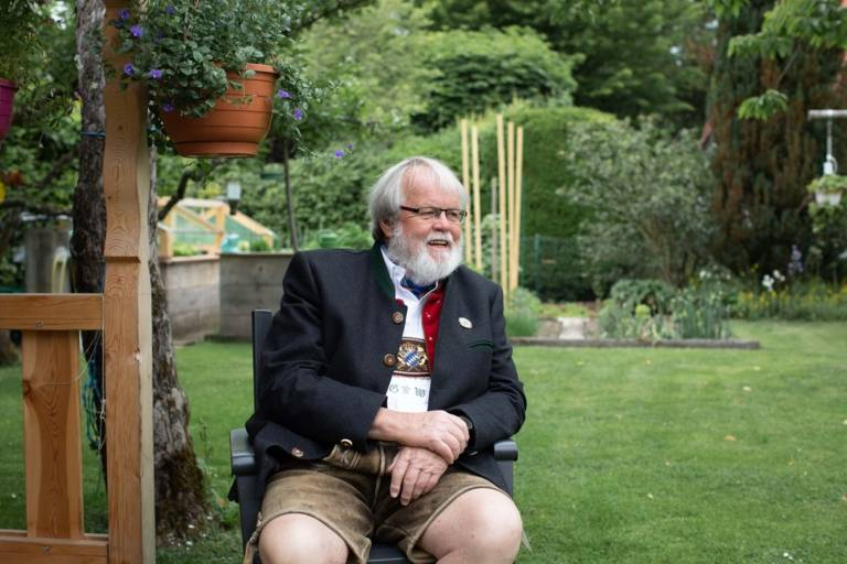 Günter Werner sits in a garden near Munich