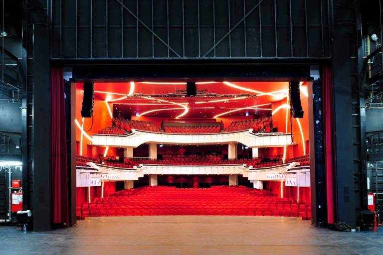 Stage and auditorium of the Deutsches Theater in Munich photographed from the rear area of the stage.